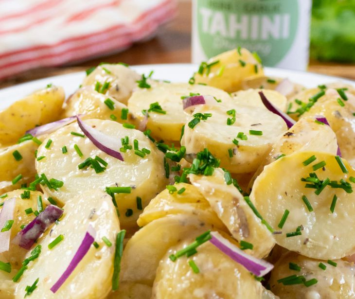 Nutritious vegan potato salad with our Herb & Garlic Dressing
